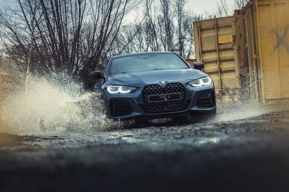 car in rain and mud