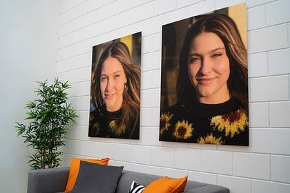 2 portrait xpozer prints hanging on wall