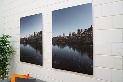 2 cityscape xpozer prints hanging on wall